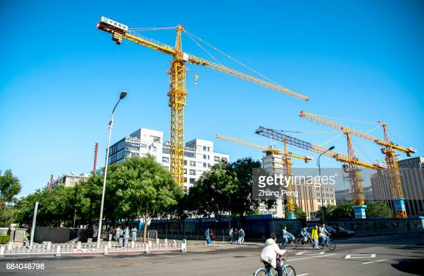 Tower cranes work on a construction site According to the National Bureau of statistics in the four months of 2017 though the increase speed of the...