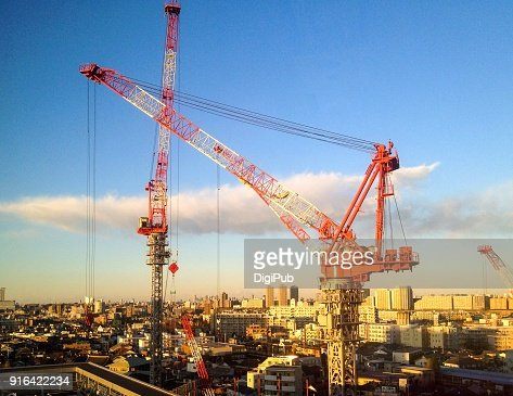 Tower cranes working at dusk