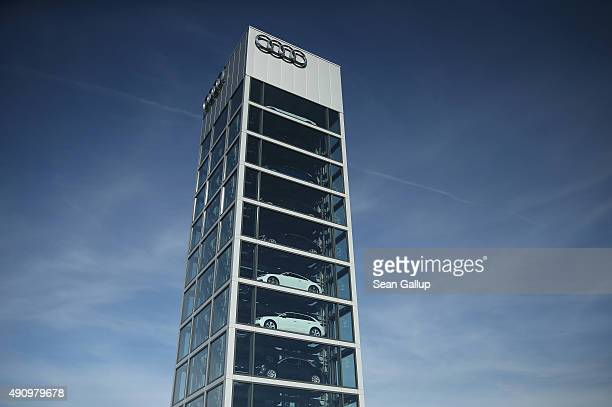 A tower filled with Audi cars stands at an Audi dealership on October 2 2015 in Berlin Germany Volkswagen the parent company of Audi announced...