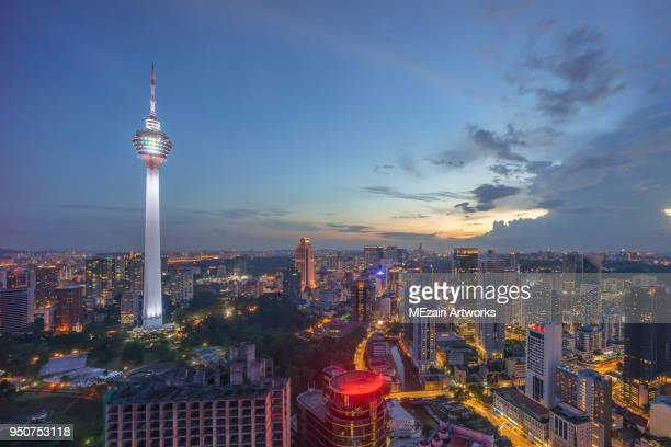 kl tower in blue hour dusk - menara kuala lumpur tower stock photos and pictures