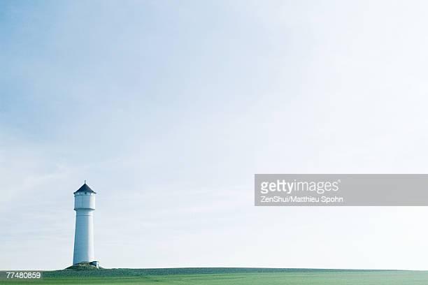 Tower in green field