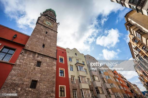 tower in innsbruck historic city center - innsbruck stock pictures, royalty-free photos & images
