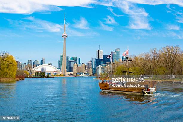 CN tower in Toronto skyline seen from Lake Ontario Pirate Life Boat ride The city offers boat tours which are very popular with tourists and visitors...