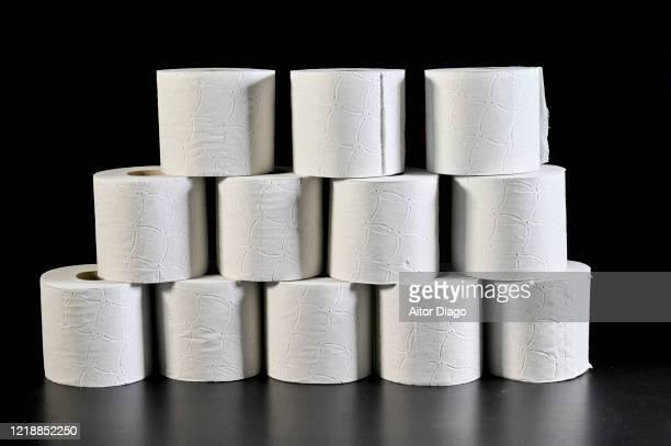 tower made of toilet paper rolls. storage concept. - emorroidi foto e immagini stock
