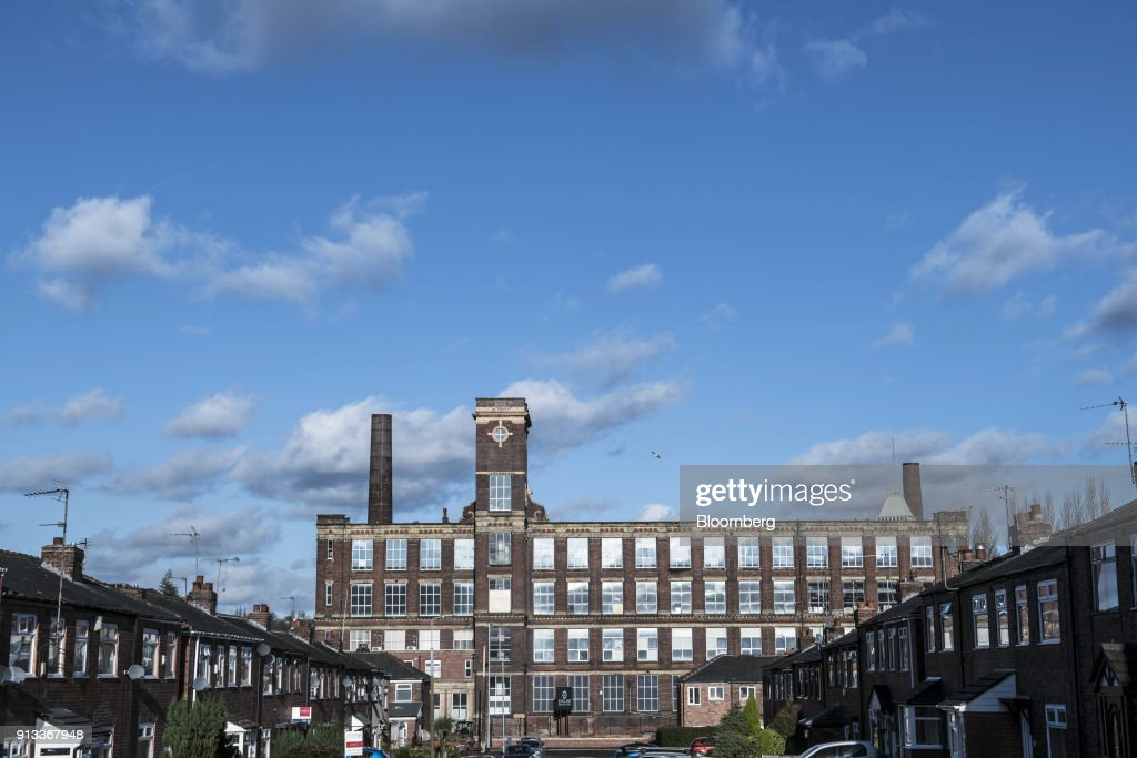 Tower Mill stands beyond housing in Manchester, U.K., on Friday, Jan. 26, 2018. The restoration of Tower Mill and the launch of English Fine Cottons as the only commercial cotton spinner in the UK, has brought an industry back to its spiritual home in the North West of England. Photographer: Matthew Lloyd/Bloomberg via Getty Images