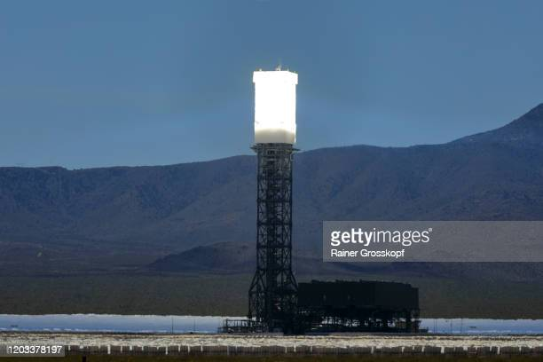 tower of a solar power facility in a desert landscape at the base of mountains - rainer grosskopf ストックフォトと画像