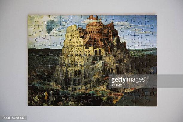 tower of babel jigsaw puzzle - tower of babel stock photos and pictures