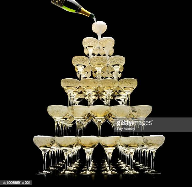 Tower of champagne glasses, studio shot