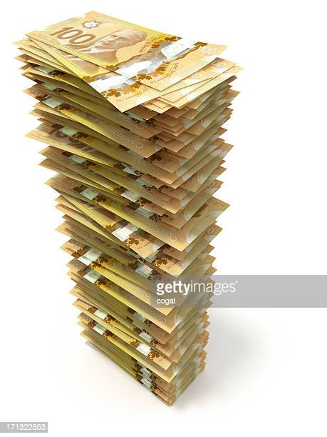 tower of crisp canadian hundred dollar bills on white - canadian dollars stock pictures, royalty-free photos & images