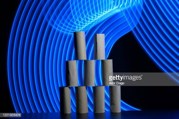 tower of empty paper rolls in a futuristic background with curved blue lines. - hemorroide fotografías e imágenes de stock