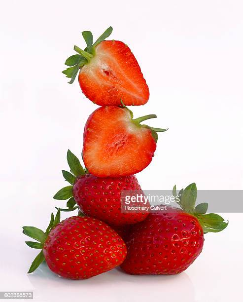 Tower of fresh, ripe strawberries, on white
