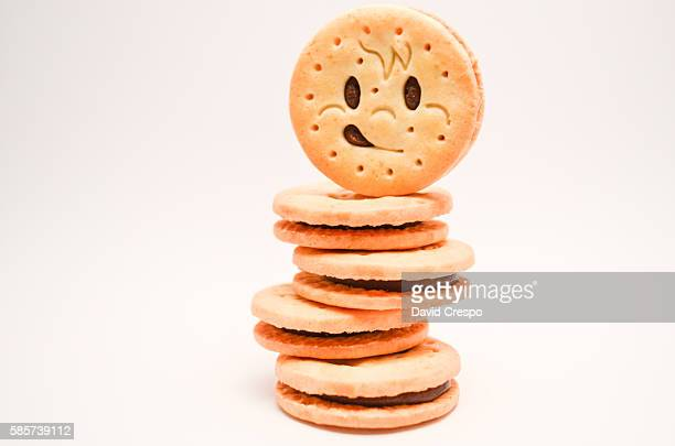 tower of happy cookies - cracker snack stock photos and pictures