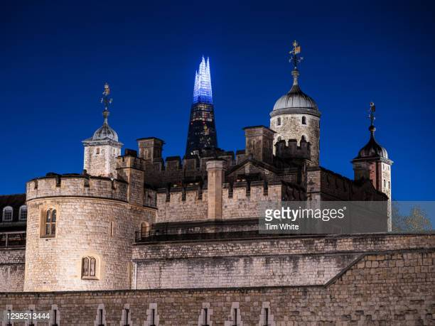 tower of london and shard at night, london, uk - night stock pictures, royalty-free photos & images