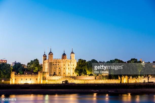 tower of london dusk light england - castle stock photos and pictures