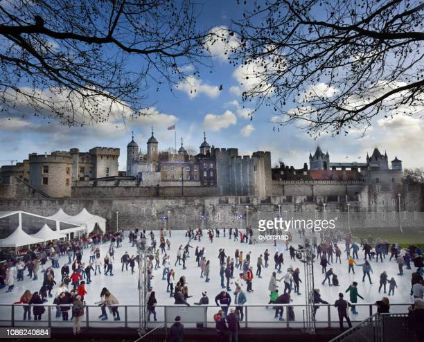 tower of london ice skaters - christmas scenes stock photos and pictures