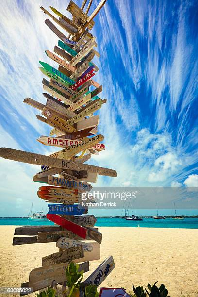 Tower of signs on Exuma Island Bahamas letting anyone who comes know that they have truly distanced themselves from the hustle and bustle of everyday...
