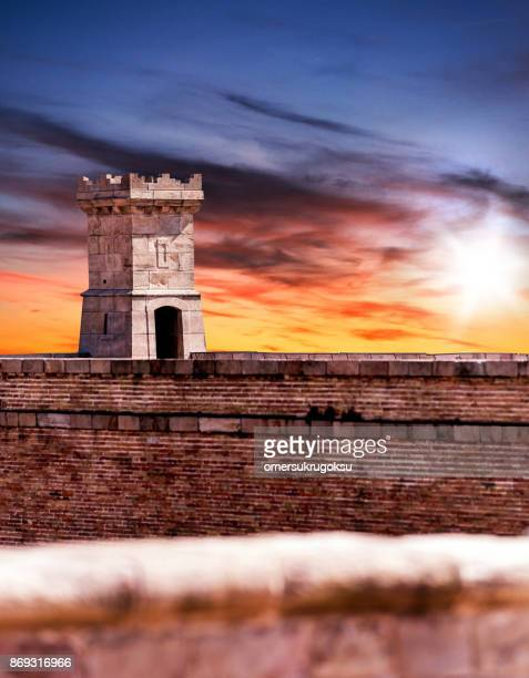 Tower of the castle at sunset in Montjuic, Barcelona, Spain