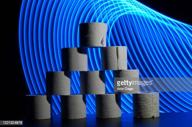 tower of toilet paper rolls in a futuristic background with curved blue lines. - hemorroide fotografías e imágenes de stock