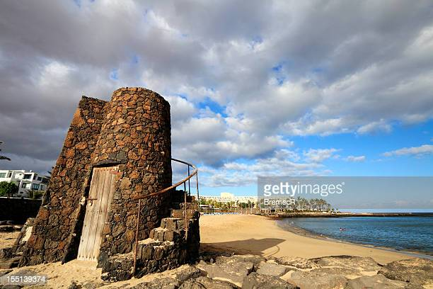 tower on cucharas beach - lanzarote stock pictures, royalty-free photos & images