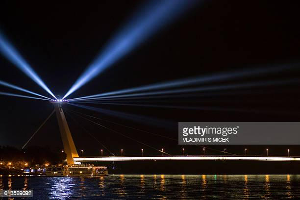 UFO Tower on the SNP bridge which is one of the most significant symbols of the Slovak capital illuminates its surroundings with a ray of light as a...