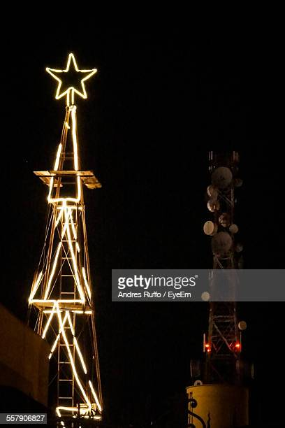 tower with christmas decorations against sky - andres ruffo stock photos and pictures