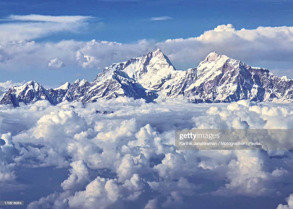 Towering above the clouds : Stock Photo