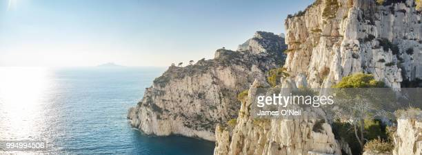 towering limestone sea-cliffs and open ocean panoramic - calanques stock pictures, royalty-free photos & images