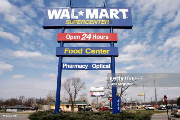 A towering sign announces a WalMart SuperCenter on Walton Blvd named after WalMart founder Sam Walton March 16 2005 in Bentonville Arkansas Based in...