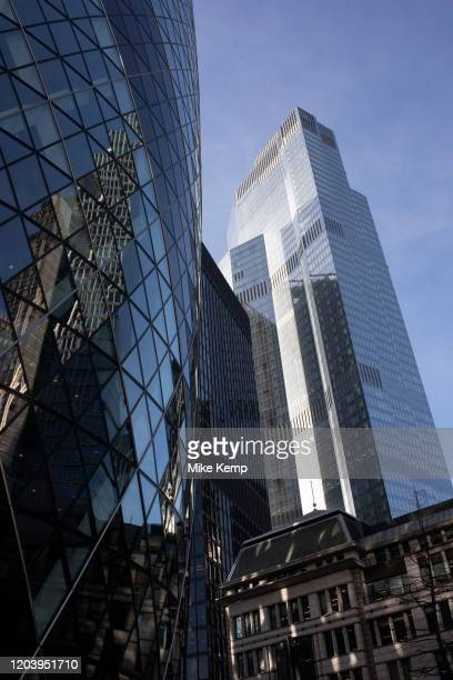 Towering skyscrapers of The Gerkhin or 30 St Mary Axe and 100 Bishopsgate in the City of London on 28th January 2020 in London England United Kingdom...