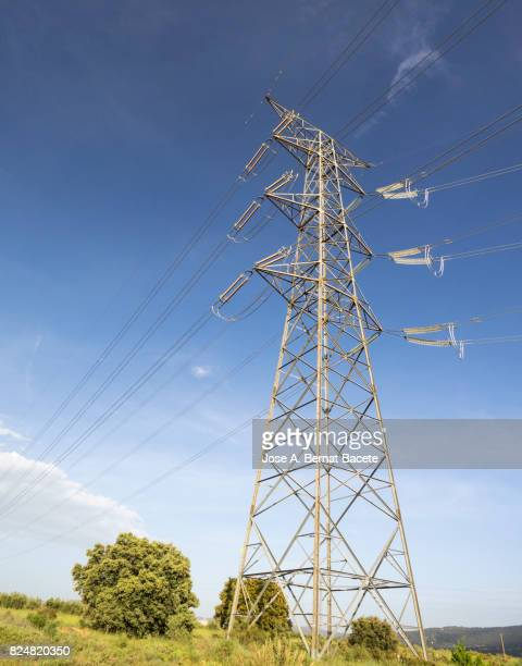Towers and electrical cables of high tension a day blue sky Spain