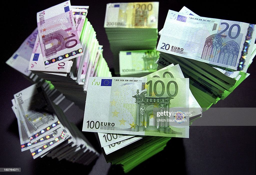 Towers of Euro banknotes , with the value of 5 20 200 and 500 Euro