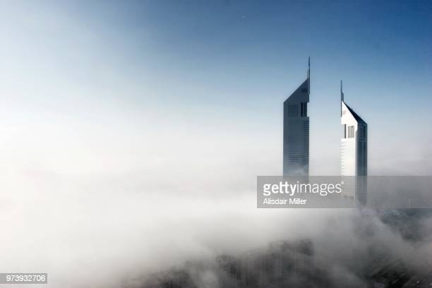 towers of jumeirah emirates hotel in clouds, dubai, united arab emirates - skyscraper stock pictures, royalty-free photos & images