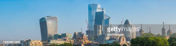 towers of london city skyscrapers illuminated at sunrise panorama uk - building exterior stock pictures, royalty-free photos & images