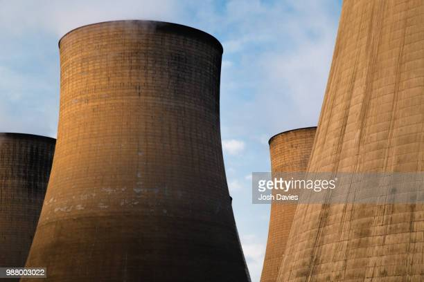 towers of power - cooling tower stock pictures, royalty-free photos & images