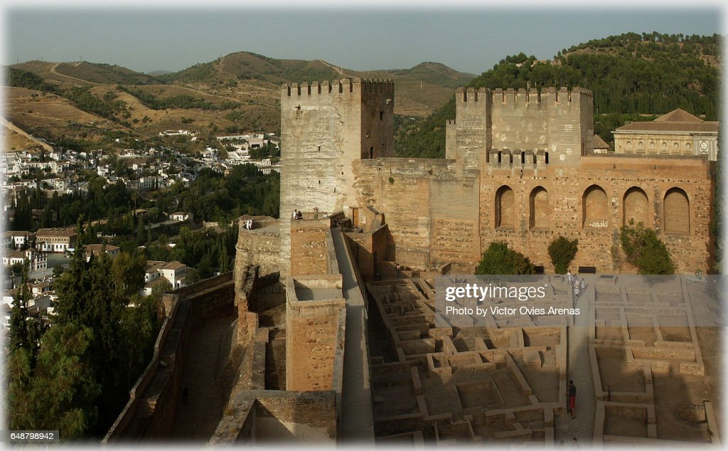 Towers of the Alcazaba and towers of the Alhambra at sunset with the Sacromonte and the Albaicin neighbourhoods in the background in Granada, Andalusia, Spain : Stock Photo