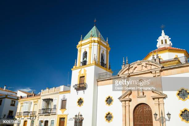 towers of the church parroquia de nuestra señora del socorro in plaza de socorro, ronda, andalucia, spain - ronda fotografías e imágenes de stock