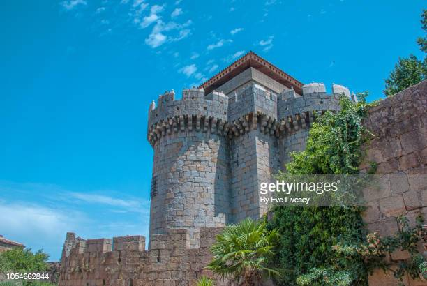 towers of the town walls granadilla on a blue sky - lookout tower stock pictures, royalty-free photos & images
