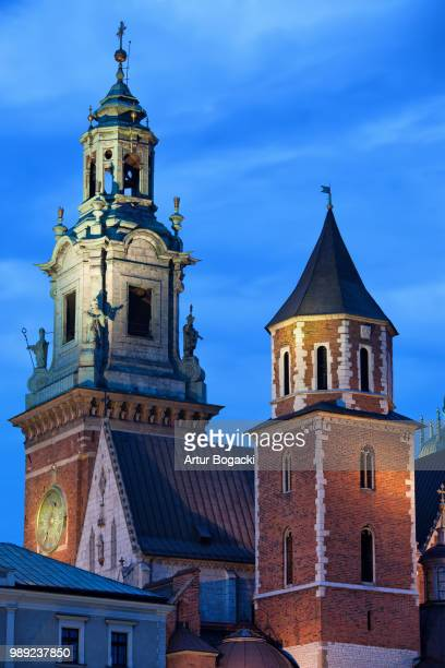 towers of the wawel royal cathedral in krakow by night - royal cathedral stock pictures, royalty-free photos & images