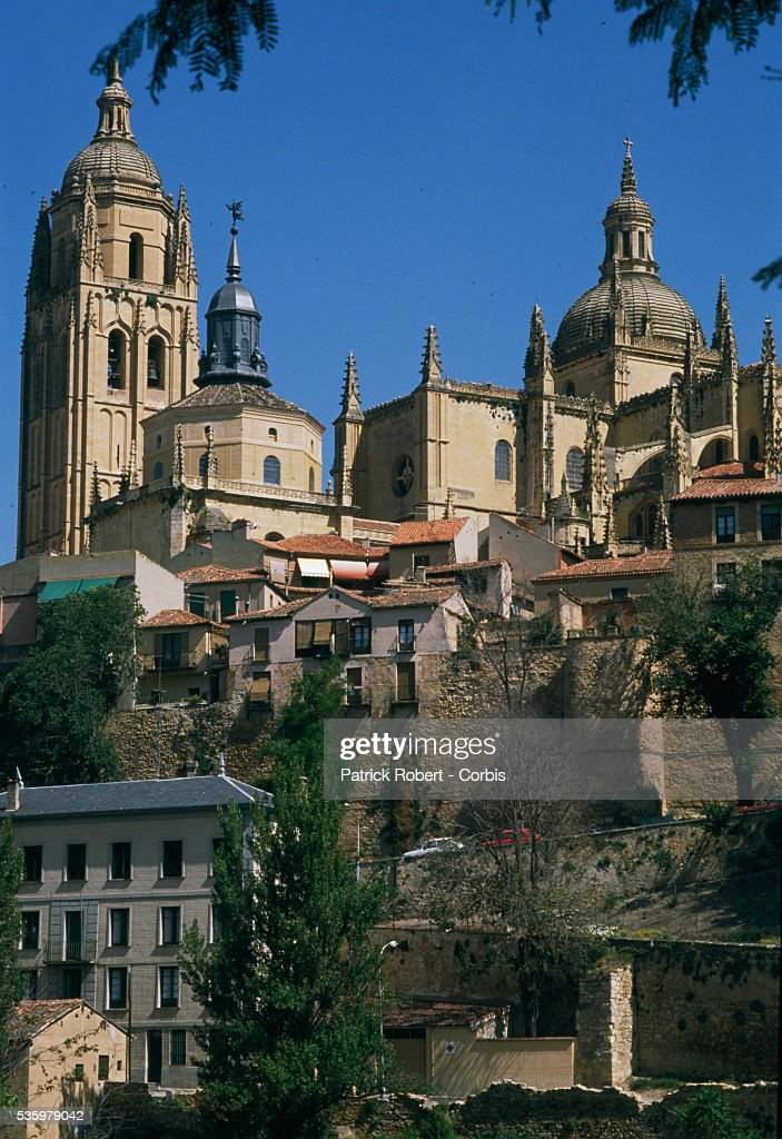 Towers on the Segovia Cathedral rise above the city's houses. Segovia is home to professional cyclist Pedro Delgado.