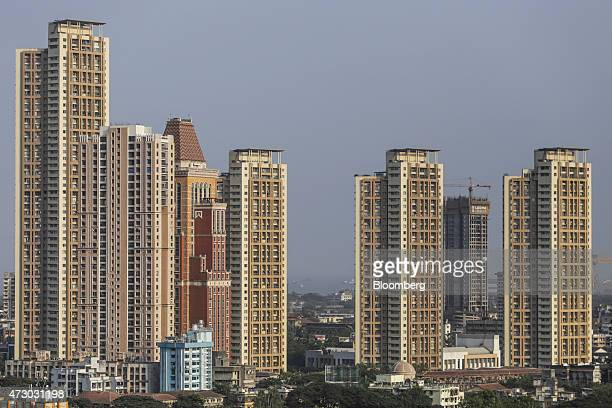 Towers stand among other residential and commercial buildings in the Mahalaxmi area of Mumbai India on Monday May 11 2015 Mumbai's longcherished...