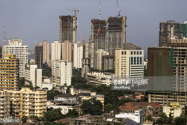 Towers stand under construction among other residential and commercial buildings in the Mahalaxmi area of Mumbai India on Monday May 11 2015 Mumbai's...