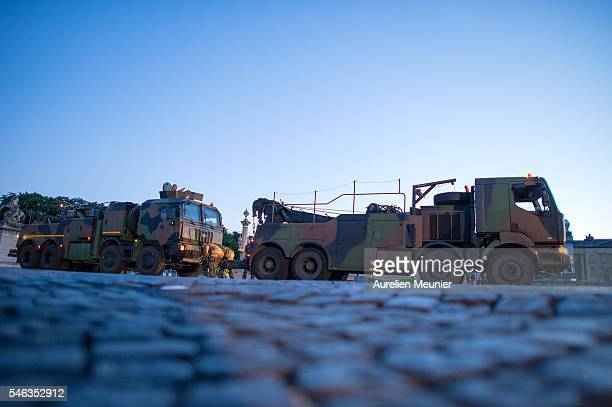 A towing exercise between two army trucks during the rehearsal for the French day parade on the July 14 on the Avenue des ChampsElysees on July 12...