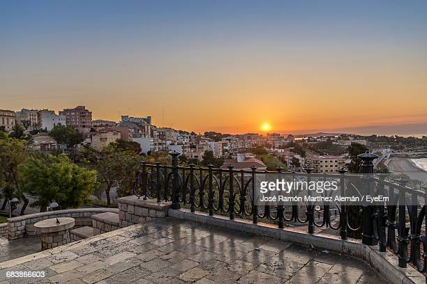 town against sky during sunset - tarragona stock photos and pictures