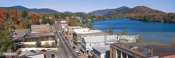 town and lake placid - lake placid stock pictures, royalty-free photos & images