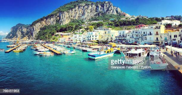 town and sea against clear sky - capri stock pictures, royalty-free photos & images