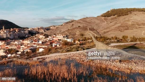 town by mountains against sky - fossil site stock pictures, royalty-free photos & images
