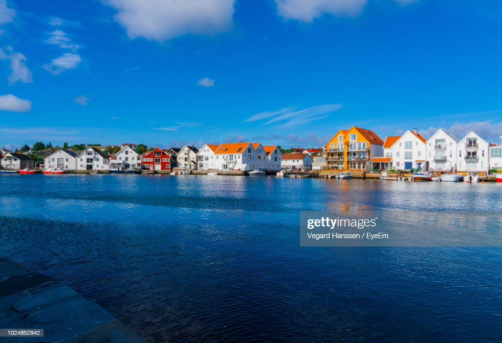 Town By Sea Against Blue Sky : Stock Photo