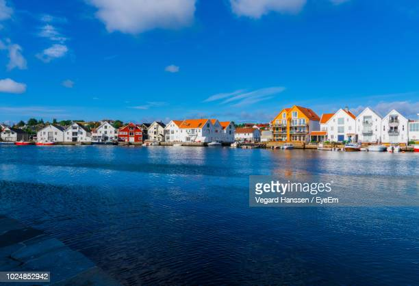 town by sea against blue sky - vegard hanssen stock pictures, royalty-free photos & images