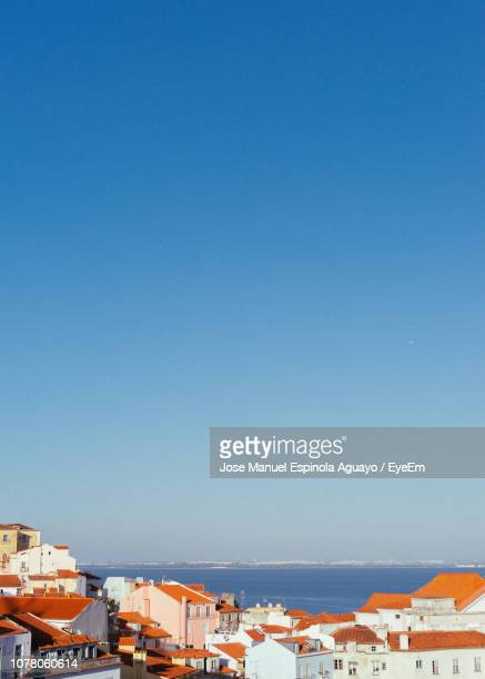 town by sea against clear blue sky - southern europe stock pictures, royalty-free photos & images