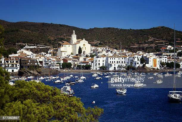 town by sea against clear blue sky - cadaques stock pictures, royalty-free photos & images